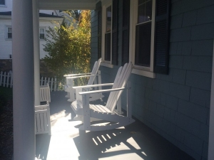 FRONT PORCH OF SMALL BLUE HOME