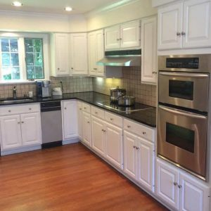 Kitchen with refinished cabinets